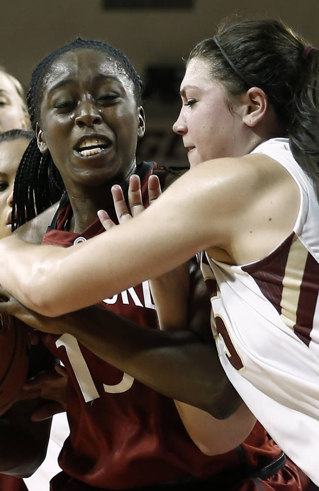 CORRECTS ID TO CHINEY OGWUMIKE, NOT ALEXA COULOMBE - Stanford's Chiney Ogwumike, left, tries to keep the ball away from Boston College's Katie Zenevitch, right, during the first half of an NCAA college basketball game at Conte Forum in Boston Saturday, Nov. 9, 2013