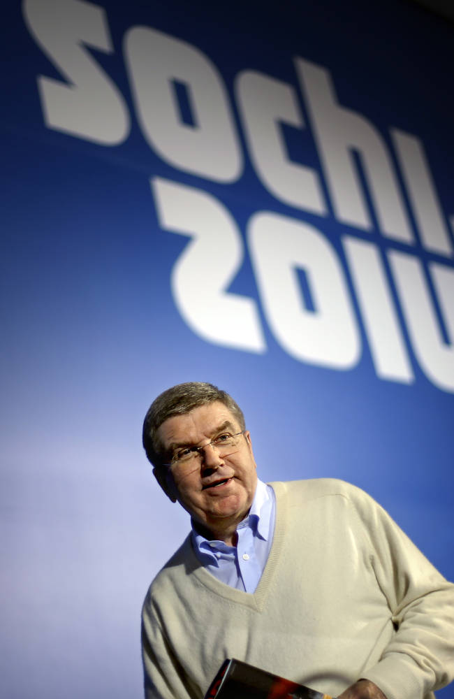 International Olympic Committee President Thomas Bach steps off the podium following a press conference at the 2014 Winter Olympics, Monday, Feb. 3, 2014, in Sochi, Russia. (AP Photo/David Goldman)