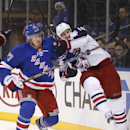 New York Rangers' Ryan McDonagh (27) battles for the puck against Columbus Blue Jackets' R.J. Umberger (18) during the third period of an NHL hockey game Thursday, Dec. 12, 2013, in New York. The Blue Jackets won 4-2 The Associated Press