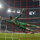 Manchester United's goalkeeper David de Gea is beaten by a header from Bayern's Mario Mandzukic to score his sides equalising goal during the Champions League quarterfinal second leg soccer match between Bayern Munich and Manchester United in the Allianz