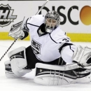 Los Angeles Kings goalie Jonathan Quick (32) stops a shot on goal against the San Jose Sharks during the first period in Game 4 of the Western Conference semifinals in the NHL hockey Stanley Cup playoffs in San Jose, Calif., Tuesday, May 21, 2013. (AP Photo/Marcio Jose Sanchez)