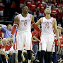 Houston Rockets' Chandler Parsons (25) puts his arm around Dwight Howard (12) after Howard fouled out of the game during overtime in Game 1 of an opening-round NBA basketball playoff series against the Portland Trail Blazers Sunday, April 20, 2014, in Hou