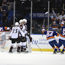 New York Islanders center Anders Lee (27), Mikhail Grabovski (84) and Frans Nielsen (51) celebrate Lee's goal as the Colorado Avalanche Maxime Talbot (25) reacts in the first period of an NHL hockey game at Nassau Coliseum on Tuesday, Nov. 11, 2014, in Un