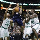Atlanta Hawks' Jeff Teague (0) shoots between Boston Celtics' Paul Pierce (34), Chris Wilcox (44) and Brandon Bass (30) during the first quarter of an NBA basketball game in Boston, Friday, March 29, 2013. (AP Photo/Michael Dwyer)