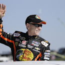 Sprint Cup Series driver Mark Martin (14) waves to the crowd during driver introductions for the NASCAR Sprint Cup auto race at Martinsville Speedway in Martinsville, VA., Sunday, Oct. 27, 2013. (AP Photo/Steve Helber)