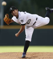 Colorado Rockies starting pitcher Jorge De La Rosa delivers against the Florida Marlins in the first inning of a baseball game in Denver, Wednesday, July 24, 2013. (AP Photo/Joe Mahoney)