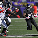 Baltimore Ravens running back Justin Forsett (29) rushes the ball past Atlanta Falcons defenders in the second half of an NFL football game, Sunday, Oct. 19, 2014, in Baltimore The Associated Press