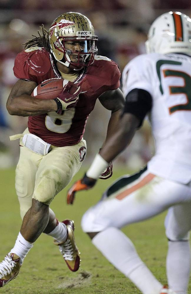 Florida State running back Devonta Freeman (8) runs towards Miami defensive back Ladarius Gunter (37) during the third quarter of an NCAA college football game Saturday, Nov. 2, 2013, in Tallahassee, Fla