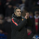 Manchester United's Robin van Persie applauds supporters after the English Premier League soccer match between Manchester United and Leicester at Old Trafford Stadium, Manchester, England, Saturday Jan. 31, 2015