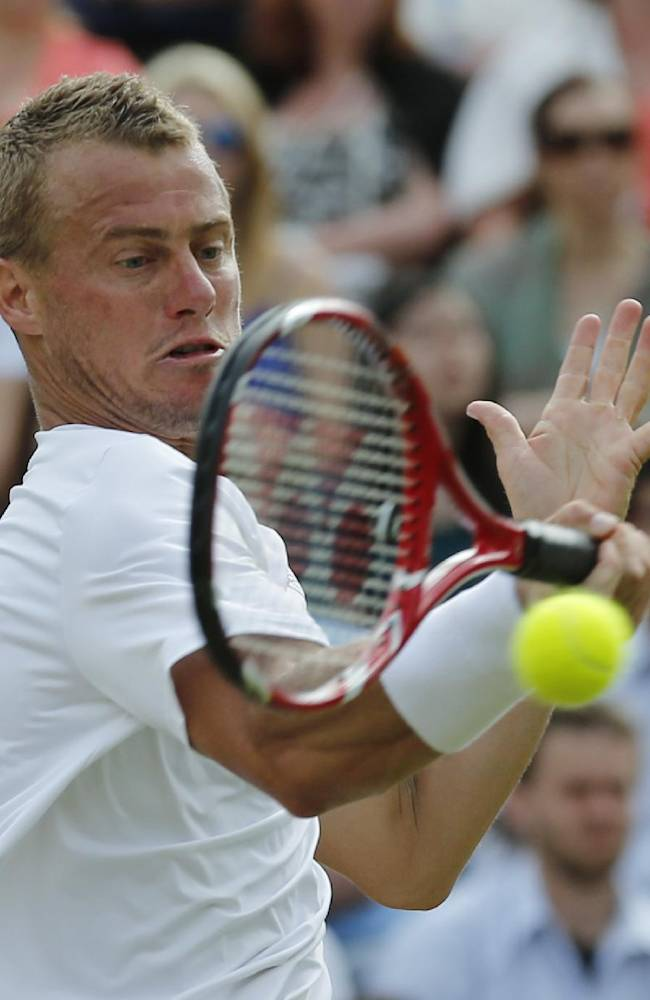 Lleyton Hewitt of Australia plays a return to Jerzy Janowicz of Poland during their men's singles match at the All England Lawn Tennis Championships in Wimbledon, London, Friday, June 27, 2014