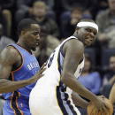 Memphis Grizzlies' Zach Randolph, right, is pressured by Oklahoma City Thunder's Kendrick Perkins, left, in the first half of an NBA basketball game in Memphis, Tenn., Wednesday, Dec. 11, 2013 The Associated Press