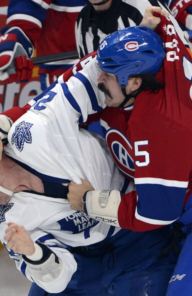 Canadiens' Parros leaves on stretcher after fight