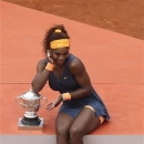 Serena Williams, of the U.S, poses with the trophy for photographers after defeating Russia's Maria Sharapova during the Women's final match of the French Open tennis tournament at the Roland Garros stadium Saturday, June 8, 2013 in Paris. Williams won 6-4, 6-4. (AP Photo/David Vincent)