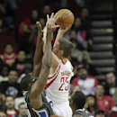 Houston Rockets small forward Chandler Parsons (25) is fouled by Orlando Magic power forward Jason Maxiell (54) as he drives to the basket during the second quarter of an NBA basketball game on Sunday, Dec. 8, 2013, in Houston The Associated Press