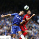 Chelsea's Branislav Ivanovic, left, competes for the ball with Leicester City's Leonardo Ulloa during their English Premier League soccer match at Stamford Bridge, London, Saturday, Aug. 23, 2014