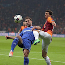 Alex Telles of Galatasaray, right, and Branislav Ivanovic of Chelsea fight for the ball during their Champions League Round of 16, First Leg match between Galatasaray and Chelsea at Turk Telekom Arena Stadium in Istanbul, Turkey, Wednesday, Feb. 26, 2014