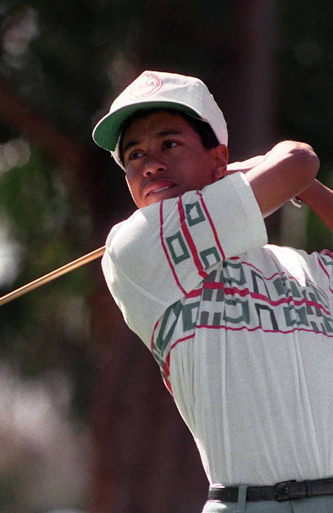 In this Feb. 26, 1992 file photo, amateur Tiger Woods tees off at the 11th hole during the Pro-Am for the Los Angeles Open at Riviera Country Club in Los Angeles.  Woods made his PGA Tour debut at Riviera when he was a 16-year-old junior in high school