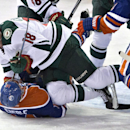 Minnesota Wild's Ryan Carter (18) jumps onto Edmonton Oilers' Jordan Eberle (14) during the third period of an NHL hockey game Tuesday, Jan. 27, 2015, in Edmonton, Alberta The Associated Press