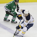Buffalo Sabres left wing Matt Moulson (26) skates with the puck past Dallas Stars center Tyler Seguin (91) during the first period of an NHL hockey game Monday, March 3, 2014, in Dallas The Associated Press