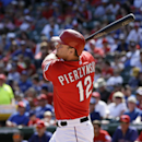In this Sept. 29, 2013, file photo, Texas Rangers' A.J. Pierzynski (12) follows through on a double to center that came off a pitch from Los Angeles Angels starting pitcher Jason Vargas in the fifth inning of a baseball game in Arlington, Texas. A person