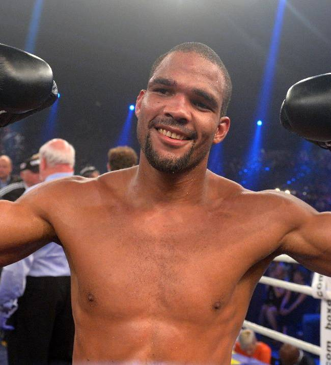In this picture taken Saturday Aug. 16, 2014, Cuban boxer Yoan Pablo Hernandez,  celebrates after defeating  Germany's  Firat Arslan  in a  IBF Cruiserweight title bout, in Erfurt, eastern Germany. Yoan Pablo Hernandez of Cuba retained his IBF cruiserweight title by split decision over German challenger Firat Arslan on Saturday