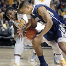 VCU's Mo Alie-Cox and George Washington's Joe McDonald fight for control of the ball under the basket during an NCAA college basketball game at the Siegel Center in Richmond, Va., on Tuesday, Jan. 27, 2015. VCU won 72-48. (AP Photo/Richmond Times-Dispatch, Alexa Welch Edlund)