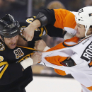 Boston Bruins' Shawn Thornton (22) and Philadelphia Flyers' Jay Rosehill (37) fight in the first period of an NHL hockey game in Boston, Saturday, April 5, 2014 The Associated Press