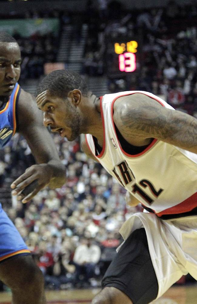 Portland Trail Blazers forward LaMarcus Aldridge, right,  drives on Oklahoma City Thunder center Kendrick Perkins during the second half of an NBA basketball game against the Oklahoma Thunder in Portland, Ore., Wednesday, Dec. 4, 2013.  Aldridge scored 38 points and pulled in 13 rebounds as they beat the Thunder 111-104