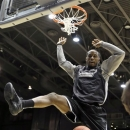 LIU Brooklyn forward Jamal Olasewere dunks during practice for a first round game of the NCAA men's college basketball tournament, Tuesday, March 19, 2013, in Dayton, Ohio. LIU is scheduled to play James Madison on Wednesday. (AP Photo/Al Behrman)