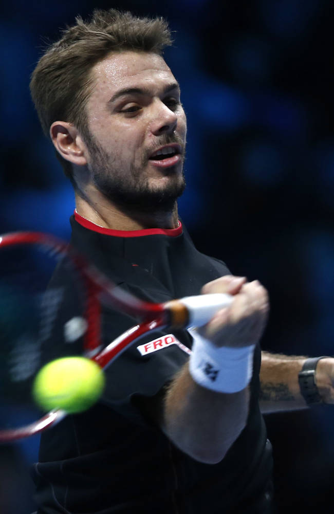 Stanislas Wawrinka of Switzerland plays a return to Tomas Berdych of Czech Republic during their ATP World Tour Finals single tennis match at the O2 Arena in London Monday, Nov. 4, 2013