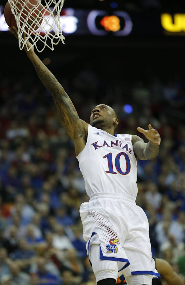 Kansas guard Naadir Tharpe (10) during the second half of an NCAA college basketball game against Oklahoma State in the quarterfinals of the Big 12 Conference men's tournament in Kansas City, Mo., Thursday, March 13, 2014. Kansas defeated Oklahoma State 77-70 in overtime