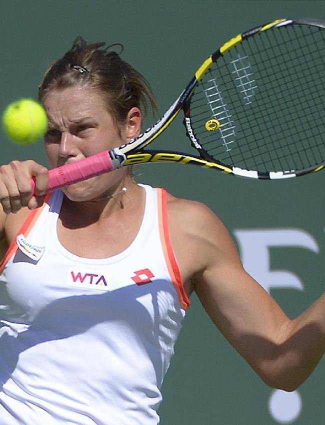 Karin Knapp, of Italy, returns a shot against Taylor Townsend in a first round match at the BNP Paribas Open tennis tournament, Thursday, March 6, 2014, in Indian Wells, Calif. Townsend won 7-6, 6-1