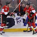 Ottawa Senators Zack Smith (15) and Chris Neil (25) check St.Louis Blues David Backes (42) during first period NHL hockey action in Ottawa Monday, Dec. 16, 2013. (AP Photo/The Canadian Press, Fred Chartrand)