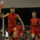 Liverpool's Steven Gerrard, left, celebrates his penalty goal against Fulham with teammate Jordan Henderson during their English Premier League soccer match at Craven Cottage, London, Wednesday, Feb. 12, 2014