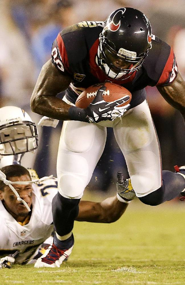 Houston Texans wide receiver Andre Johnson, right, breaks away from San Diego Chargers cornerback Derek Cox, during the second half of an NFL football game Monday, Sept. 9, 2013, in San Diego