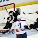 Edmonton Oilers right wing Jordan Eberle, right, scores on Anaheim Ducks goalie Frederik Andersen (31), of Denmark, during the third period of an NHL hockey game Wednesday, April 2, 2014, in Anaheim, Calif. The Ducks won 3-2 The Associated Press