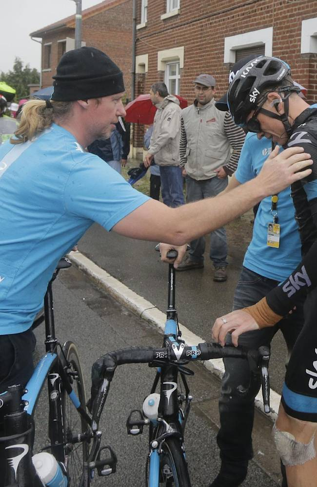 Britain's Christopher Froome gets up after a third consecutive crash in two days prior to abandoning the race during the fifth stage of the Tour de France cycling race over 155 kilometers (96.3 miles) with start in Ypres, Belgium, and finish in Arenberg, France, Wednesday, July 9, 2014. The stage initially contained nine sectors of cobblestone roads dreaded by the majority of the riders in the pack especially under wet conditions, the organization decided to cancel two of the nine stretches because of the weather