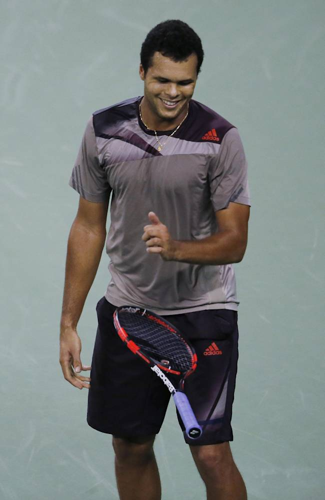 France's Jo-Wilfried Tsonga  drops his racquet as he reacts after missing a point against Serbia's Novak Djokovic during the singles semifinal match of the Shanghai Masters tennis tournament at Qizhong Forest Sports City Tennis Center in Shanghai, China, Saturday, Oct. 12, 2013. Djokovic won 6-2, 7-5