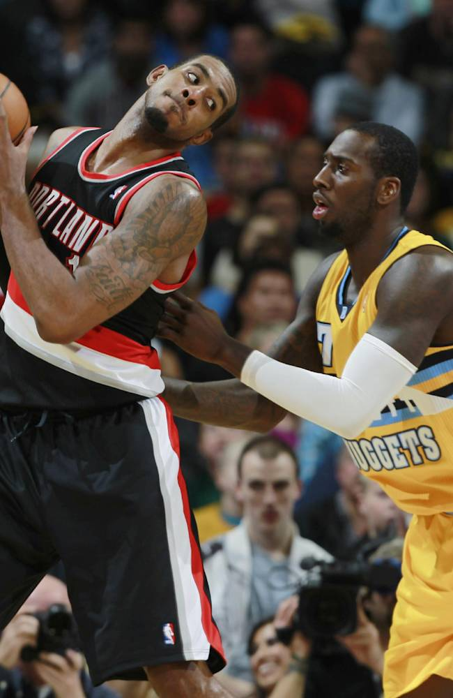 Portland Trail Blazers center LaMarcus Aldridge, left, works the ball inside for a shot as Denver Nuggets forward J.J. Hickson covers in the fourth quarter of Portland's 113-98 victory in an NBA basketball game in Denver on Friday, Nov. 1, 2013