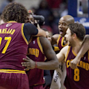Cleveland Cavaliers guard Dion Waiters, second from left, is hugged by teammate Anderson Varejao (17) after sinking a two-point basket to defeat the Detroit Pistons 97-96 as Jarrett Jack and Matthew Dellavedova (8) celebrate during an NBA basketball game