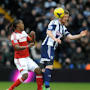 West Bromwich's Chris Brunt heads the ball away from Fulham's Hugo Rodallega during the English Premier League soccer match between West Bromwich Albion and Fulham at Hawthorns Stadium in West Bromwich, England, Saturday, Feb. 22 2014