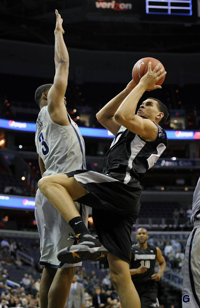 Providence forward Tyler Harris, right, goes to the basket against Georgetown forward Mikael Hopkins (3) during the first half of an NCAA college basketball game, Monday, Feb. 10, 2014, in Washington
