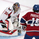 Washington Capitals goaltender Justin Peters (35) makes a save against Montreal Canadeins' Pierre-Alexandre Parenteau (15) during first-period NHL hockey preseason game action in Montreal, Sunday, Sept. 28, 2014. (AP Photo/The Canadian Press, Graham Hughes)
