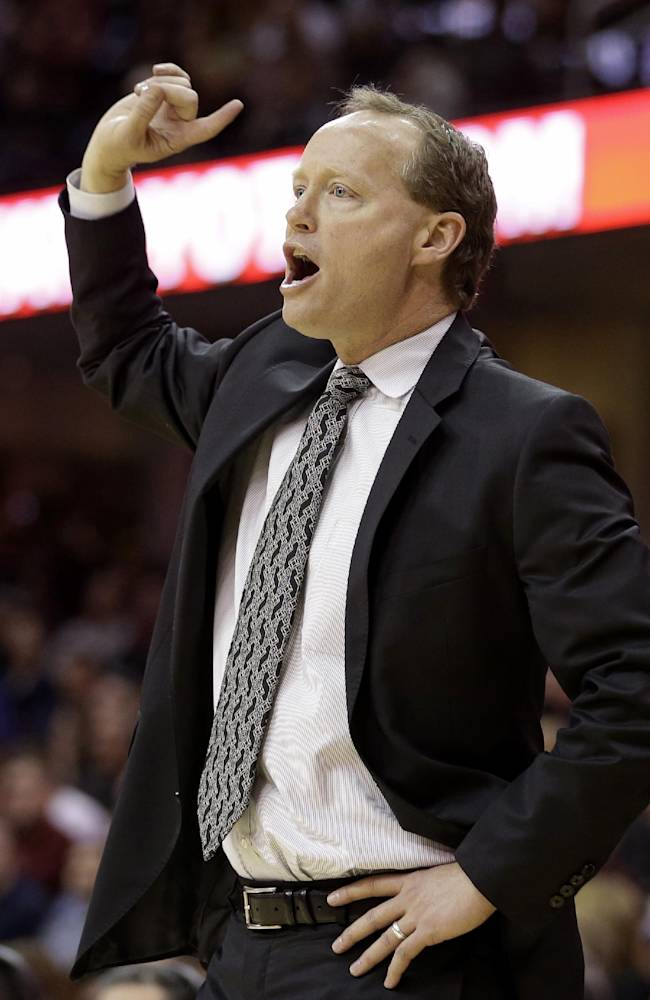Atlanta Hawks coach Mike Budenholzer gestures during the fourth quarter of an NBA basketball game against the Cleveland Cavaliers on Thursday, Dec. 26, 2013, in Cleveland. Atlanta defeated Cleveland 127-125 in double overtime