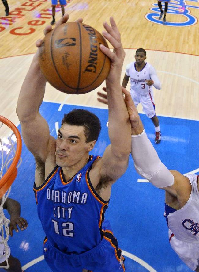 Oklahoma City Thunder center Steven Adams (12) grabs a rebound along with Los Angeles Clippers forward Blake Griffin, right, in the second half of Game 3 of the Western Conference semifinal NBA basketball playoff series, Friday, May 9, 2014, in Los Angeles. The Thunder won 118-112