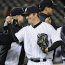 New York Yankees pitcher Adam Warren celebrates after the getting the save as his team defeated the Chicago Cubs 2-0 in Game 2 of an interleague baseball doubleheader on Wednesday, April 16, 2014, at Yankee Stadium in New York The Associated Press