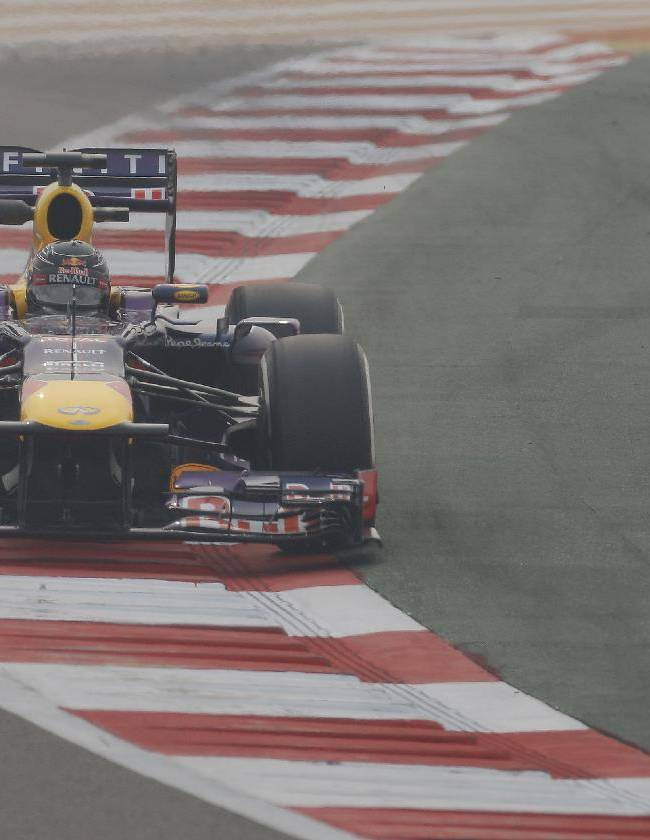 Red Bull driver Sebastian Vettel of Germany steers his car during the second practice session at the Indian Formula One Grand Prix at the Buddh International Circuit in Noida, India, Friday, Oct. 25, 2013
