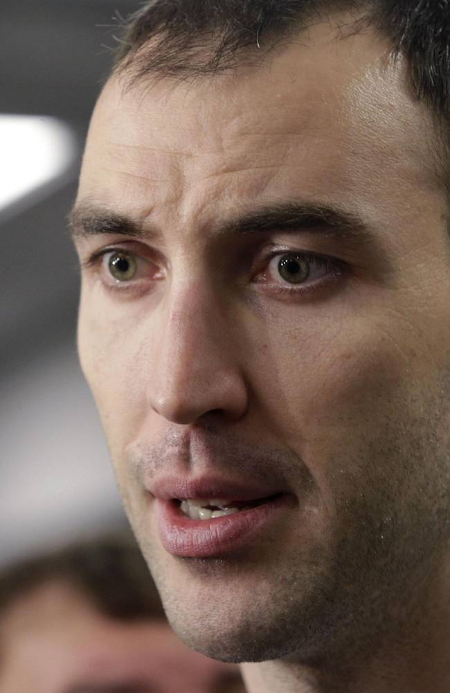 Boston Bruins captain Zdeno Chara, of Slovakia, speaks to the media in the team's locker room at TD Garden Friday, May 16, 2014, in Boston. The Montreal Canadiens eliminated the Bruins with a 3-1 win in Game 7 of their second-round Stanley Cup playoff NHL hockey series on Wednesday