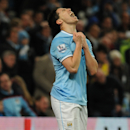 Manchester City's Samir Nasri grimaces after missing a goal scoring opportunity during the English Premier League soccer match between Manchester City and Sunderland at The Etihad Stadium, Manchester, England, Wednesday, April 16, 2014