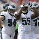 Philadelphia Eagles linebacker Brandon Graham (55) celebrates after sacking San Francisco 49ers quarterback Colin Kaepernick with defensive tackle Beau Allen (94) and defensive end Cedric Thornton (72) during the first half of an NFL football game in Sant